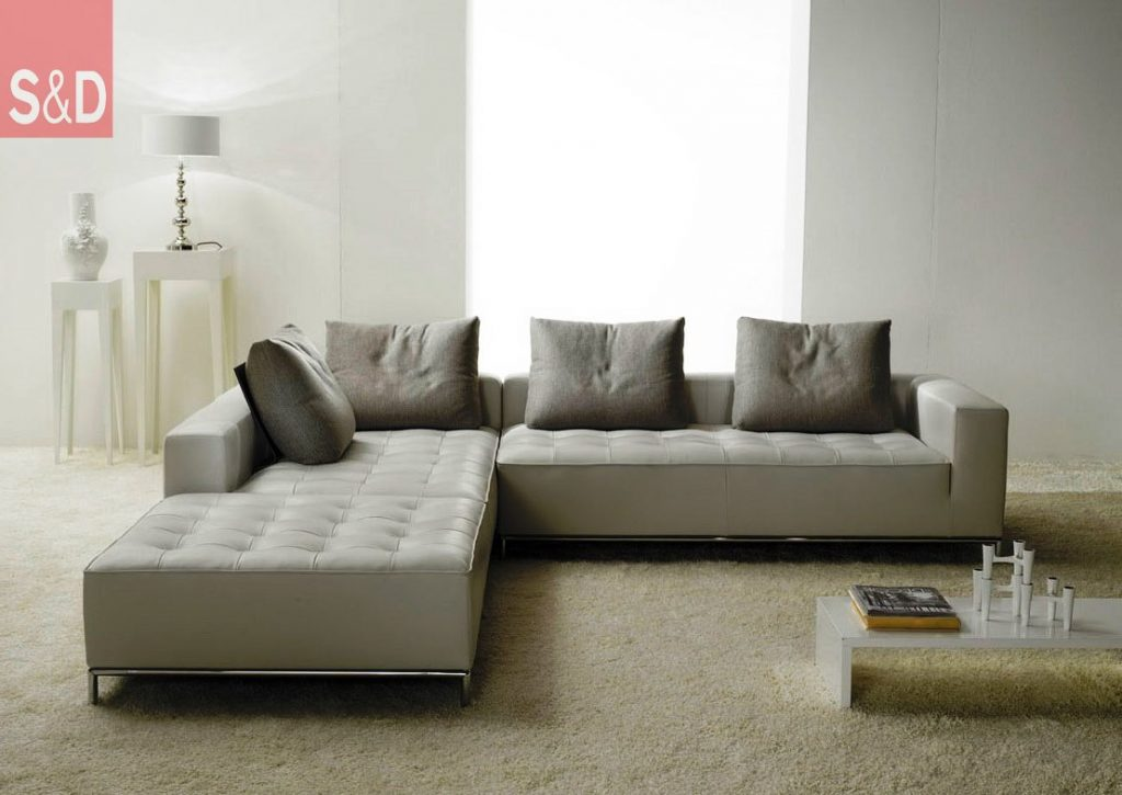 minimalist white living room with modest grey cushions on vintage l shaped ikea sofa bed 1024x725 - Угловые диваны на заказ